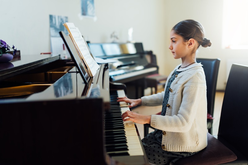 Playing Piano by Ear: Top Tips from Your Denver Piano Movers